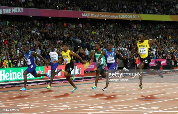 Justin Gatlin of the United States leads the Men's 100 metres final from Yohan Blake of Jamaica Christian Coleman of the United States and Usain Bolt...
