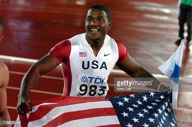 Justin Gatlin of the United States takes a victory lap with an American and Finnish flag after winning the 200 meters in 2004 to lead an American...