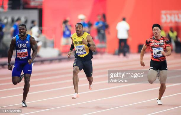 Justin Gatlin of the United States, Yohan Blake of Jamaica and Yuki Koike of Japan compete in the Men's 100 metres semi finals during day two of 17th...