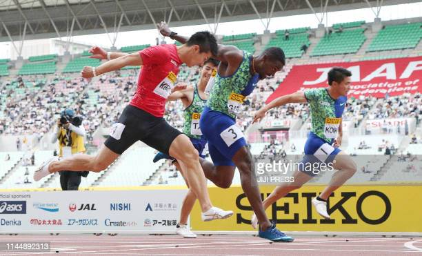 Justin Gatlin of the US crosses the finish line ahead of Yoshihide Kiryu of Japan during the final of the men's 100 metres athletics event at the...
