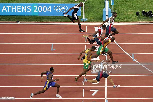 Justin Gatlin of the USA wins the 100 meter final ahead of Francis Obikwelu of Portugual Maurice Greene of the USA Shawn Crawford of the USA Asafa...