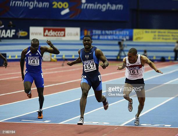 Justin Gatlin of the USA wins the Mens 60m Final during the 9th IAAF World Indoor Athletics Championships on the March 14, 2003 at the National...