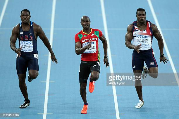 Justin Gatlin of United States, Kim Collins of Saint Kitts and Nevis and Harry Aikines-Aryeetey of Great Britain compete during the men's 100 metres...