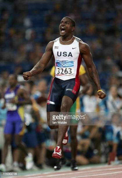 Justin Gatlin of USA celebrates after he won the men's 100 metre final on August 22, 2004 during the Athens 2004 Summer Olympic Games at the Olympic...