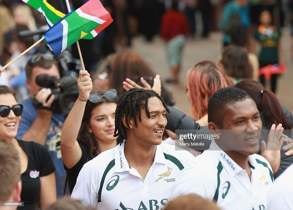 Justin Geduld (L) and Jamba Ulengo walk through the crowds in Civic Square during a South African street parade ahead of the 2014 Wellington Sevens on February 5, 2014 in Wellington, New Zealand.