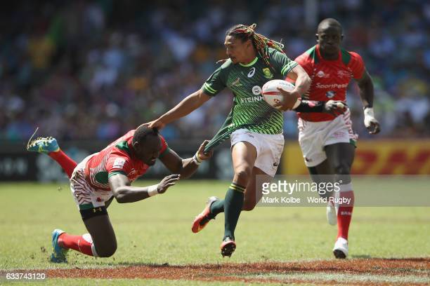 Justin Geduld of South Africa tries the evade the Kenya defence during the Mens Pool A match between South Africa and Kenya in the 2017 HSBC Sydney...