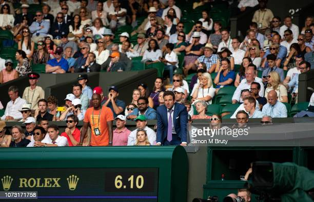 Justin Gimelstob from USA watches his friend John Isner against Kevin Anderson during The Wimbledon Lawn Tennis Championship at the All England Lawn...