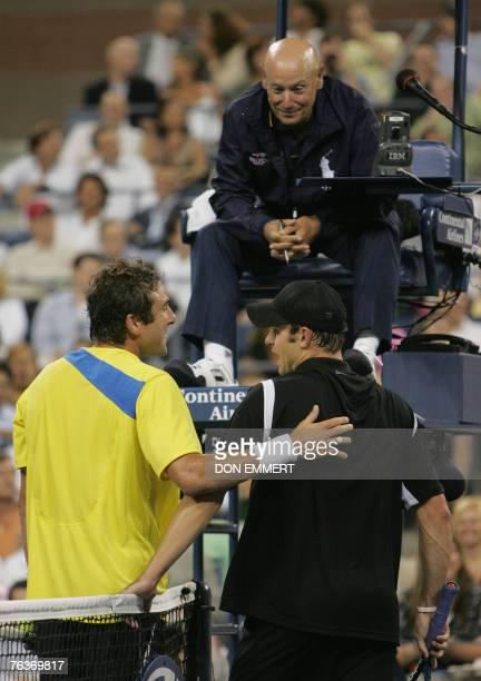 Justin Gimelstob of the US and compatriot number five seeded Andy Roddick discuss a call with the chair umpire during their match 28 August 2007 at...