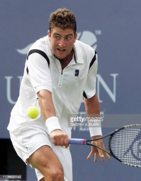 Justin Gimelstob of the US returns a backhand to number two seed Andre Agassi of the US 04 September 1999 at the US Open in Flushing Meadows New York...