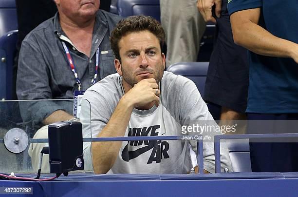Justin Gimelstob of USA cheers for his friend John Isner on day eight of the 2015 US Open at USTA Billie Jean King National Tennis Center on...