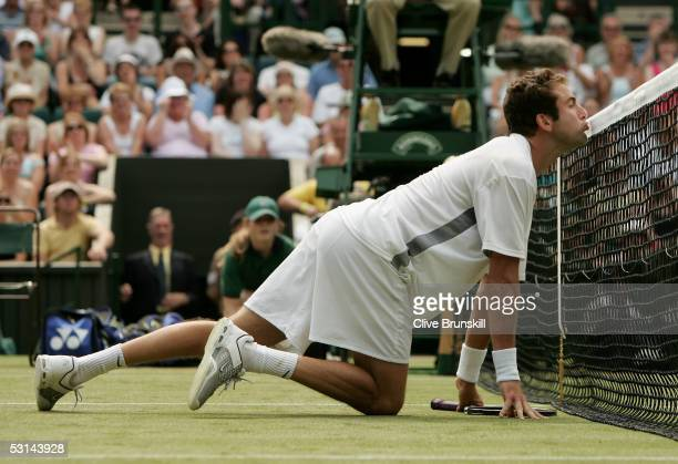 Justin Gimelstob of USA kisses the net during his match against Lleyton Hewitt of Australia during the fifth day of the Wimbledon Lawn Tennis...