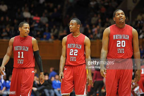 Justin Glover WyKevin Bazemore and Stephon Platt of the WinstonSalem State Rams walk back onto the court following a time out against the Duke Blue...