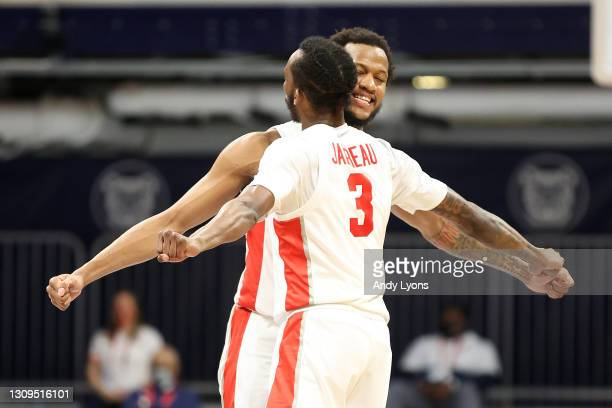 Justin Gorham and DeJon Jarreau of the Houston Cougars react in the second half of their Sweet Sixteen game against the Syracuse Orange in the 2021...