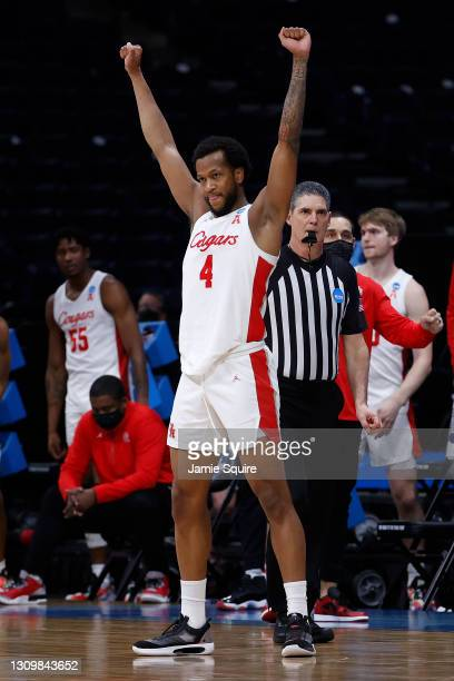 Justin Gorham of the Houston Cougars celebrates after defeating the Oregon State Beavers in the Elite Eight round of the 2021 NCAA Men's Basketball...