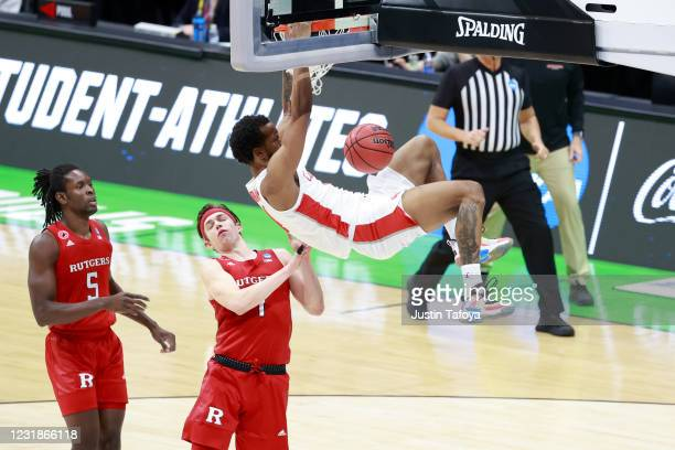 Justin Gorham of the Houston Cougars dunks the ball against the Rutgers Scarlet Knights in the second round of the 2021 NCAA Division I Mens...