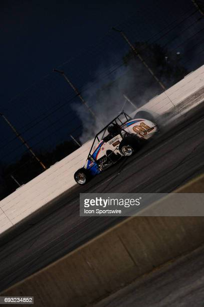 Justin Grant Carli/Hemelgarn Racing slides along the outside turn three wall in the Carb Night Classic United States Auto Club Silver Crown Champ Car...