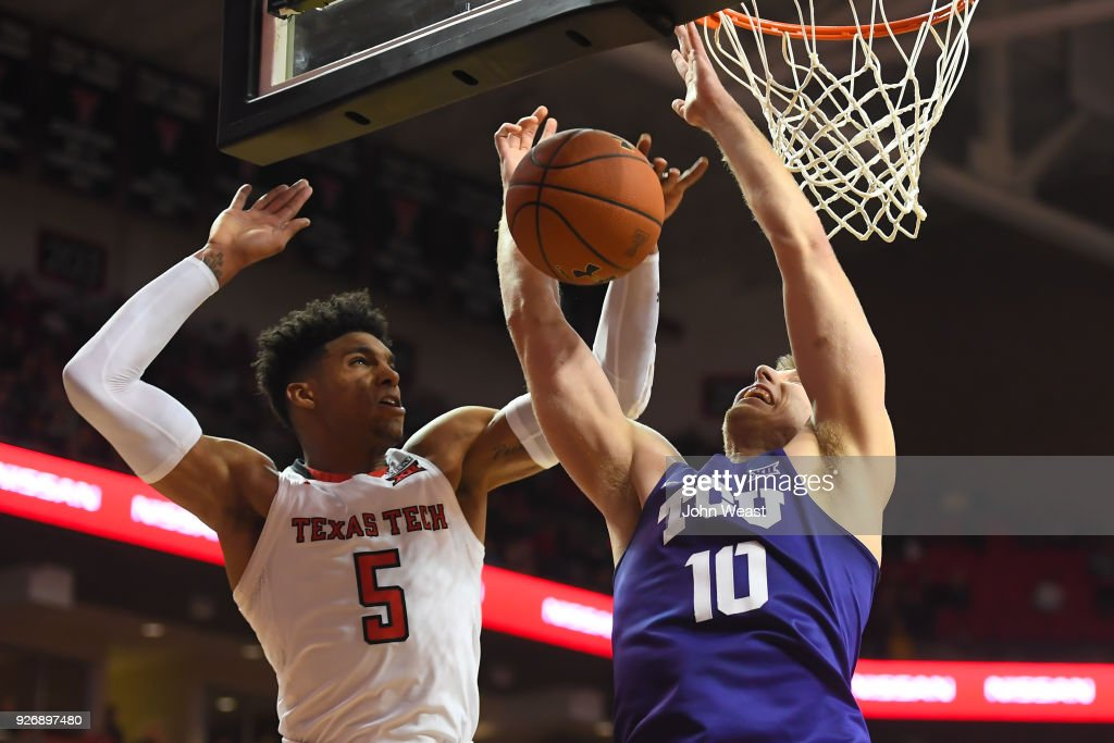 Justin Gray #5 of the Texas Tech Red Raiders blocks the shot attempt of Vladimir Brodziansky #10 of the TCU Horned Frogs during the second half of the game on March 3, 2018 at United Supermarket Arena in Lubbock, Texas. Texas Tech defeated TCU