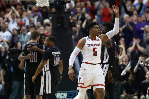 Justin Gray of the Texas Tech Red Raiders celebrates their 7060 win over the Stephen F Austin Lumberjacks in the first round of the 2018 NCAA Men's...