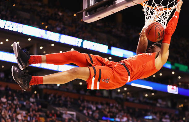 Justin Gray of the Texas Tech Red Raiders dunks the ball during the second half against the Purdue Boilermakers in the 2018 NCAA Men's Basketball...