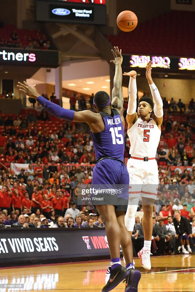 Justin Gray #5 of the Texas Tech Red Raiders shoots the ball over JD Miller #15 of the TCU Horned Frogs during the second half of the game on March 3, 2018 at United Supermarket Arena in Lubbock, Texas. Texas Tech defeated TCU