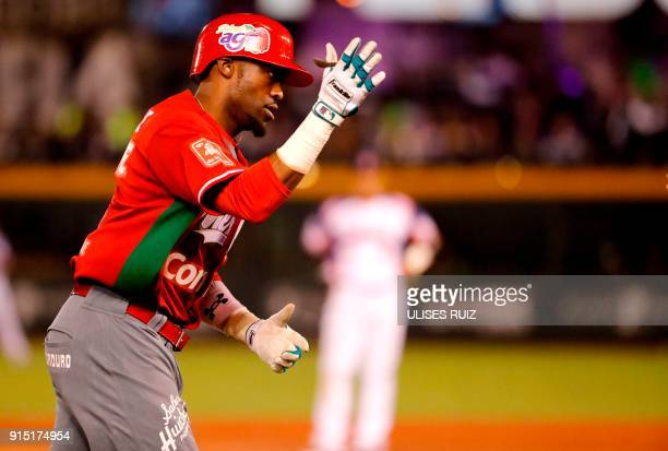 Justin Greene of Tomateros de Culiacan of Mexico celebrates after scoring against Aguilas Cibaenas of Republica Dominicana during the Caribbean...