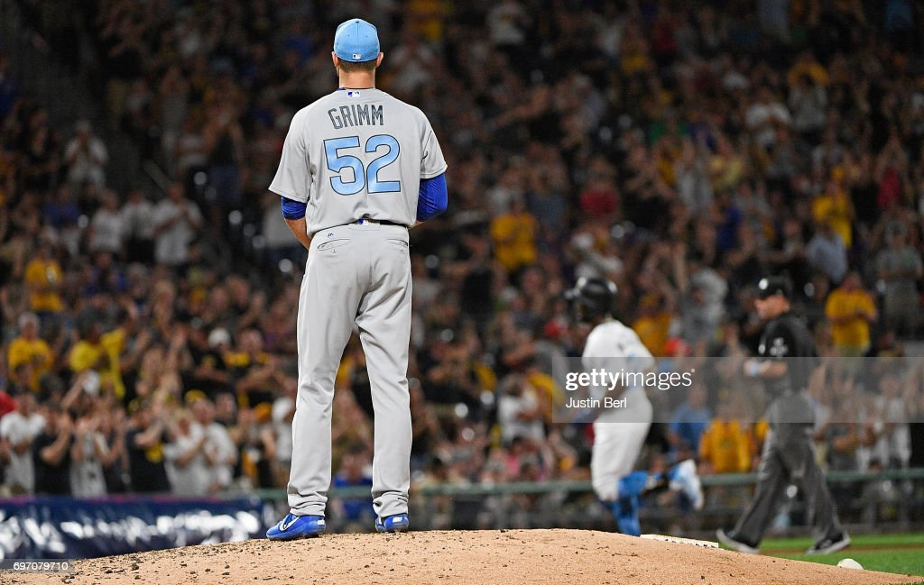 Justin Grimm #52 of the Chicago Cubs reacts as Andrew McCutchen #22 of the Pittsburgh Pirates rounds the bases after hitting a solo home run in the sixth inning during the game at PNC Park on June 17, 2017 in Pittsburgh, Pennsylvania.