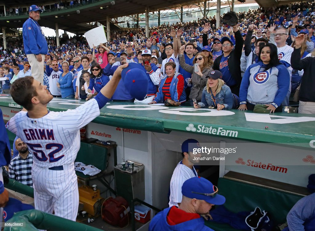 Justin Grimm #52 of the Chicago Cubs tosses his hat to the fans after the last regular season game against the Cincinnati Reds at Wrigley Field on October 1, 2017 in Chicago, Illinois. The Reds defeated the Cubs 3-1.
