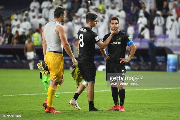 Justin Gulley of Team Wellington is consoled by Henry Cameron as he misses the decisive penalty as Khalid Eisa of Al Ain celebrates in the shoot out...