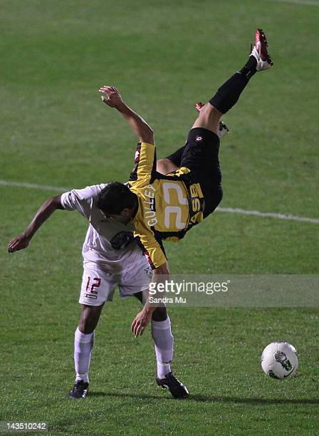 Justin Gulley of Wellington flips over Roy Krishna of Waitakere during the 2012 ASB Premiership Grand Final match between Waitakere United and Team...