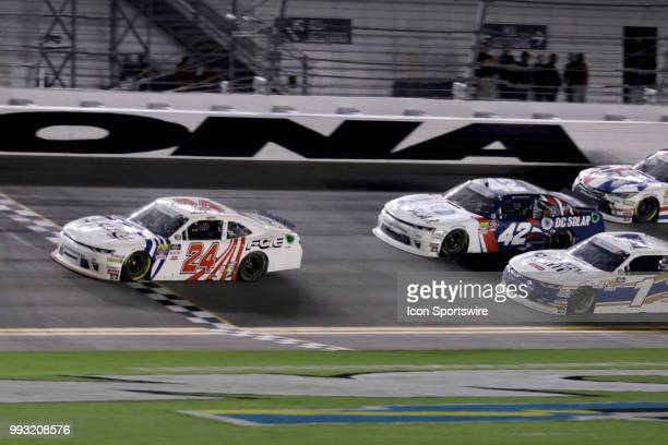 Justin Haley driver of the FOE Chevy crosses the finish line first but was relegated to 18th at the end of the CocaCola Firecracker 250 race on July...