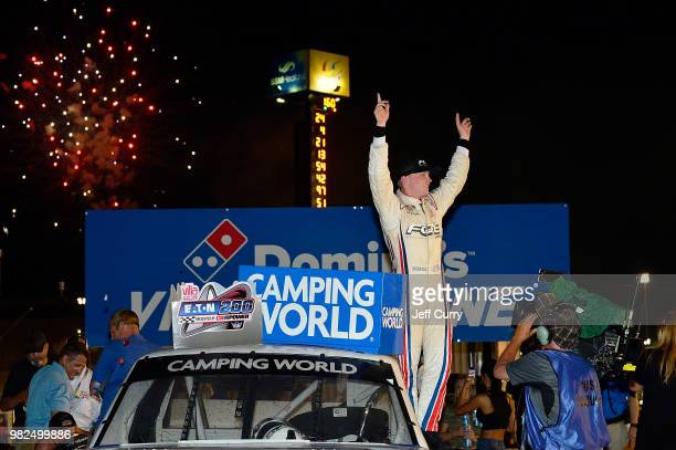 Justin Haley driver of the Fraternal Order Of Eagles Chevrolet celebrates after winning the NASCAR Camping World Truck Series Villa Lighting delivers...