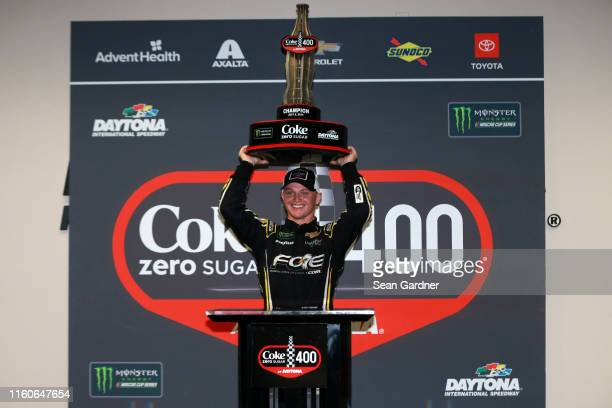 Justin Haley driver of the Fraternal Order of Eagles Chevrolet celebrates in victory lane after winning the Monster Energy NASCAR Cup Series Coke...