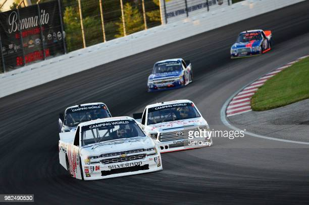 Justin Haley driver of the Fraternal Order Of Eagles Chevrolet leads a pack of trucks during the NASCAR Camping World Truck Series Villa Lighting...