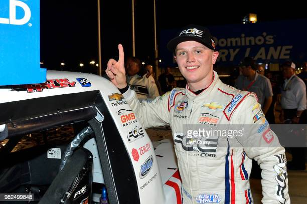 Justin Haley driver of the Fraternal Order Of Eagles Chevrolet poses for a photo with the winning sticker after winning the NASCAR Camping World...