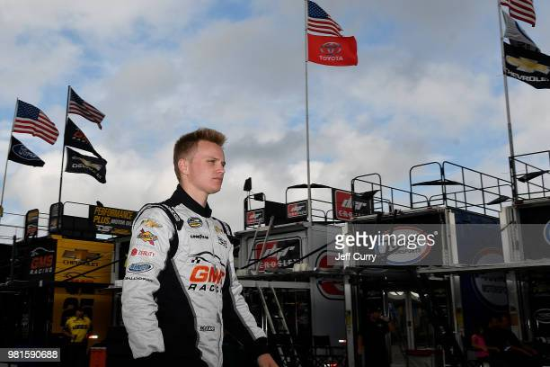 Justin Haley driver of the Fraternal Order Of Eagles Chevrolet walks through the garage during practice for the NASCAR Camping World Truck Series...