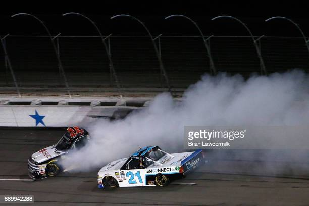 Justin Haley driver of the Zeality Chevrolet is involved in an ontrack incident in front of Johnny Sauter driver of the ISMConnect Chevrolet during...