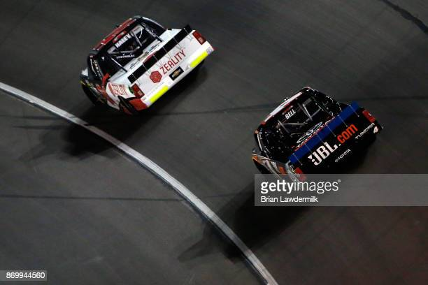 Justin Haley driver of the Zeality Chevrolet leads Christopher Bell driver of the JBL Toyota during the NASCAR Camping World Truck Series JAG Metals...