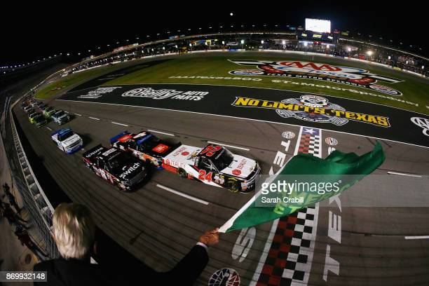 Justin Haley driver of the Zeality Chevrolet leads the field to the green flag to start the NASCAR Camping World Truck Series JAG Metals 350 Driving...