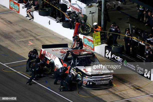 Justin Haley driver of the Zeality Chevrolet pits during the NASCAR Camping World Truck Series JAG Metals 350 Driving Hurricane Harvey Relief at...
