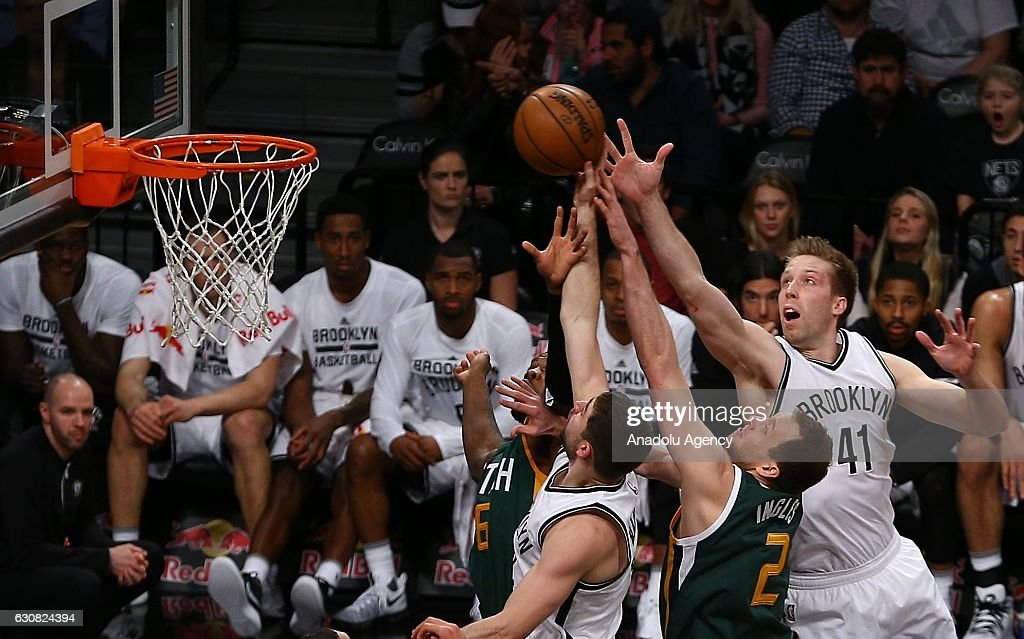 Justin Hamilton (R) of Brooklyn Nets in action against Joe Ingles (2nd R) of Utah Jazz during NBA game between Brooklyn Nets and Utah Jazz at Barclays Center in New York City, United States on January 03, 2017.