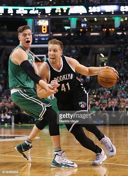 Justin Hamilton of the Brooklyn Nets drives against Jonas Jerebko of the Boston Celtics during the second half at TD Garden on October 26 2016 in...
