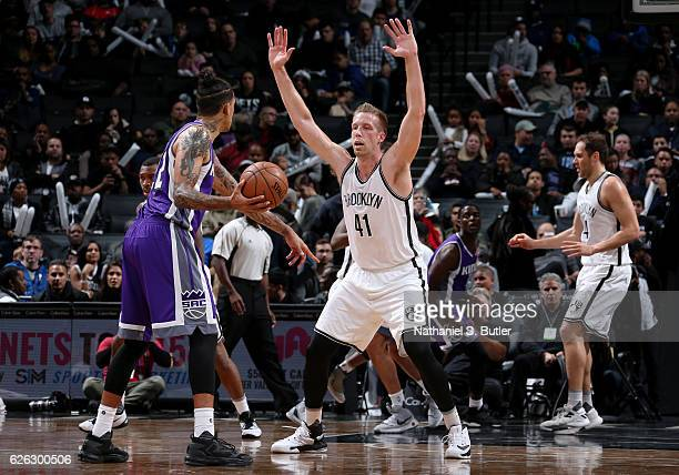 Justin Hamilton of the Brooklyn Nets plays defense against Matt Barnes of the Sacramento Kings on November 27 2016 at Barclays Center in Brooklyn NY...