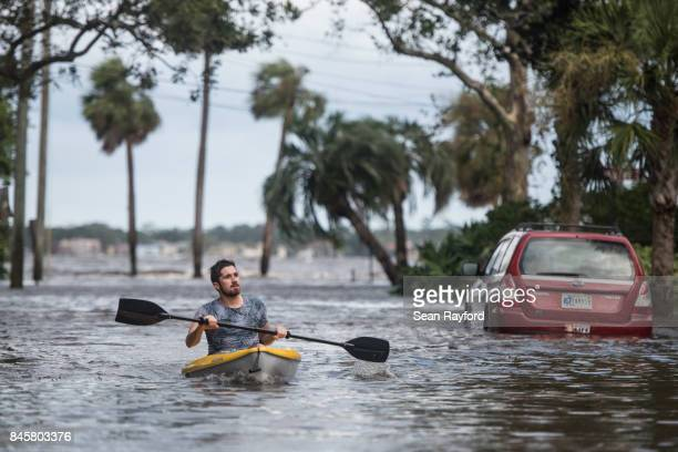 Justin Hand navigates storm surge flood waters from Hurricane Irma along the St Johns River on Sept 11 2017 in Jacksonville Florida Flooding in...