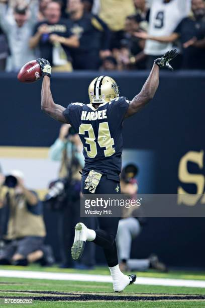 Justin Hardee of the New Orleans Saints runs in a punt that he blocked for a touchdown during a game against the Tampa Bay Buccaneers at MercedesBenz...