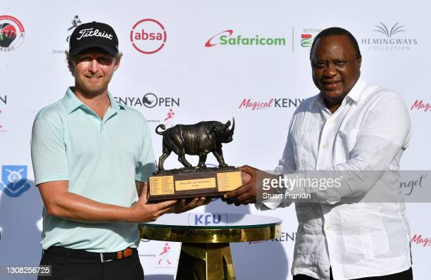 Justin Harding of South Africa and Uhuru Kenyatta, President of the Republic of Kenya pose with the trophy aduring Day Four of the Magical Kenya Open...