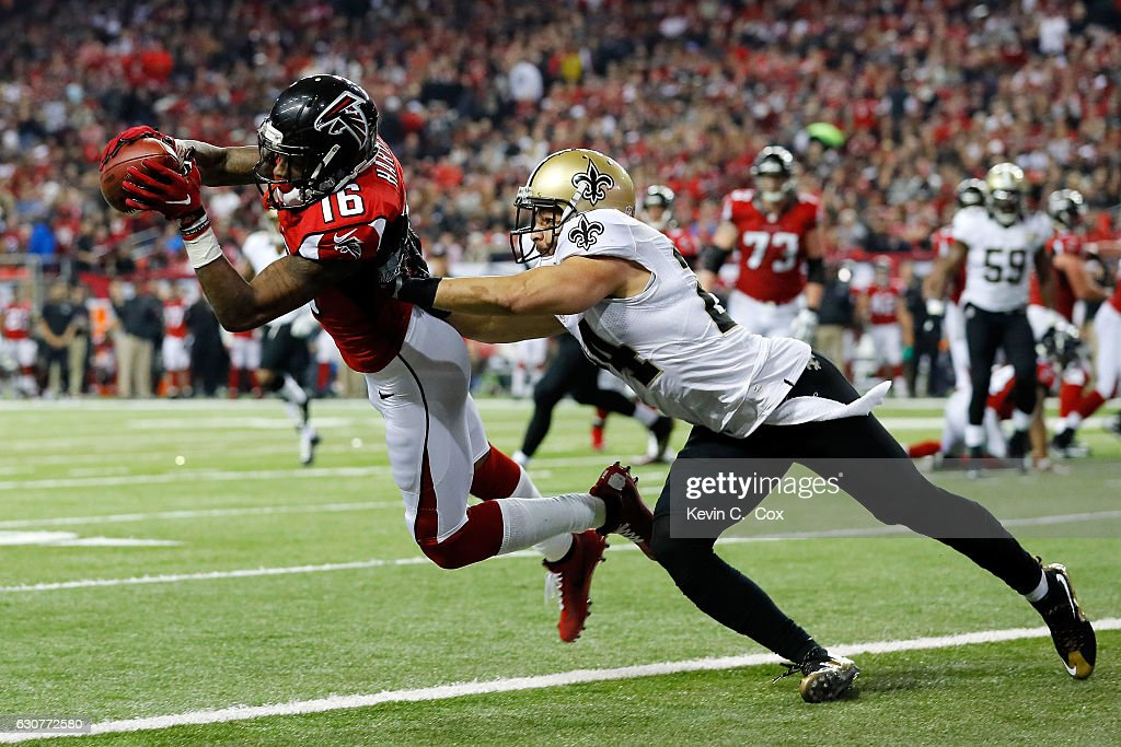 Justin Hardy #16 of the Atlanta Falcons catches a touchdown pass against Sterling Moore #24 of the New Orleans Saints during the first half at the Georgia Dome on January 1, 2017 in Atlanta, Georgia.