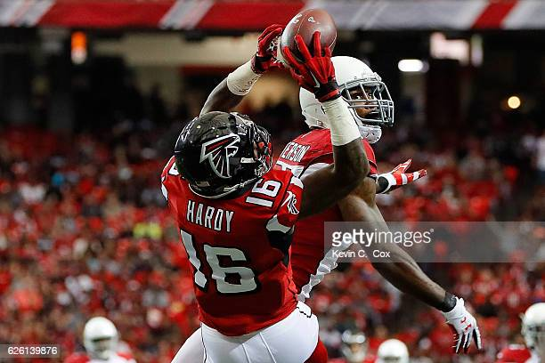 Justin Hardy of the Atlanta Falcons makes a catch over Patrick Peterson of the Arizona Cardinals during the first half at the Georgia Dome on...