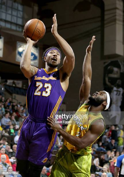 Justin Harper from the Los Angeles DFenders shoots over the defense of Jabril Trawick from the Sioux Falls Skyforce at the Sanford Pentagon March 18...