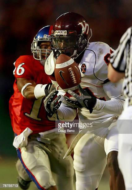 Justin Harper of the Virginia Tech Hokies can't make the reception in front of Chris Harris of the Kansas Jayhawks during the FedEx Orange Bowl at...