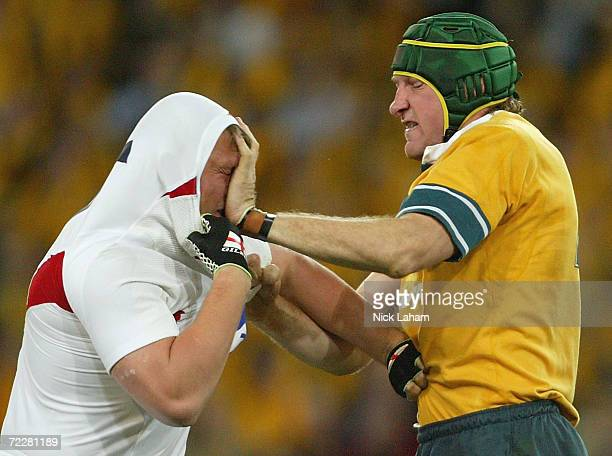 Justin Harrison of the Wallabies hits Steve Thompson of England in the face during the rugby union international match between the Australian...